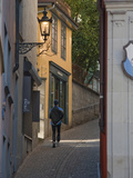 A Jogger Runs Up an Alley in Zurich's Old Town Photographic Print by Greg Dale