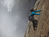 A Climber, Without a Rope, Jams Her Hands into Fissures for Ascent Photographic Print by Mikey Schaefer