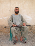 A Guard Protects a Compound in Kandahar, Afghanistan Photographic Print by Kris Leboutillier