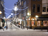 A Street Scene at Christmastime Photographic Print by Abraham Nowitz
