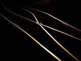 Golden Evening Sunlight Reflects Off Railroad Tracks Photographic Print by Stephen St. John