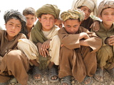 Refugee Children Sit Near a Road in Zhari Dasht, Near Kandahar Photographic Print by Kris Leboutillier