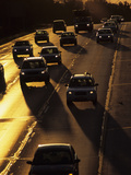 Cars Silhouetted on I-94 Interstate at Sunset Photographic Print by Paul Damien