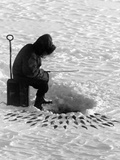 A Fisherman Fishes Through the Ice on Lake Huron Photographic Print by Thomas J. Abercrombie