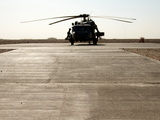 A Black Hawk Helicopter at Camp Bastion, Helmand Province Photographic Print by Kris Leboutillier
