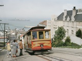 A Cable Car Stops to Pick Up Passengers on Hyde Street Photographic Print by J. Baylor Roberts