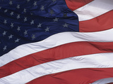 An American Flag Waving Gently in a Breeze Photographic Print by Paul Damien