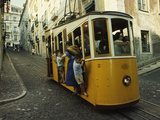 High Quarter Jam-Packed Cable Trolly Descends a Cobblestoned Street Photographic Print by Volkmar K. Wentzel