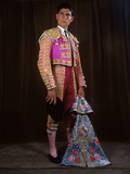 A Matador Poses in Full Regalia with an Embroidered Cape Photographic Print by Luis Marden