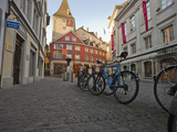 Bicycles Parked in a Cobbled Street in Zurich's Old Town in Morning Photographic Print by Greg Dale