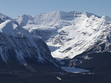 The Snow-Dusted Canadian Rocky Mountains and Lake Louise Below Photographic Print by Tim Laman
