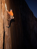 Waiting Until Night for Cooler Temperatures, a Rock Climber Ascends El Capitan Photographic Print by Jimmy Chin