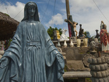 Statues of Christian Figures and Other Artworks Photographic Print by Karen Kasmauski