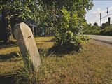 A Limestone Sign Post Sits Along Historic Maple Grove Road Photographic Print by Steve Raymer
