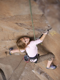 A Young Girl Rock Climbing Photographic Print by John Burcham