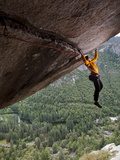 A Climber Scales a Route on Seperate Reality, a Hanging Roof Crack Photographic Print by Jimmy Chin