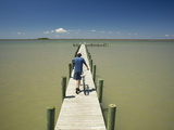 A Man Pushes a Bike on a Dock in the Chesapeake Bay Photographic Print by Aaron Huey