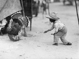 A Young Guatemalan Boy in a Straw Hat Tries to Coax a Turkey to Him Photographic Print by Luis Marden