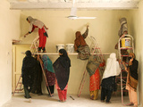 Women Paint a School Room in Jalalabad, Afghanistan Photographic Print by Kris Leboutillier