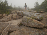 A Girl Hiking across Large Boulders in Early Morning Fog Photographic Print by Karen Kasmauski