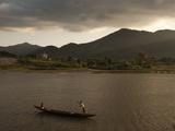 A Vietnamese Man Poleing a Canoe in a River Photographic Print by Karen Kasmauski