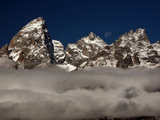 The Peak of Grand Teton Mountain Above the Clouds Photographic Print by Aaron Huey