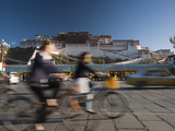 Bicyclists and Traffic in Front of the Potala Palace Photographic Print by Michael S. Yamashita