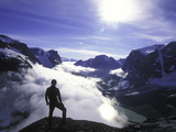 A Lone Climber Enjoys the View Above the Clouds Photographic Print by John Burcham