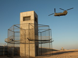 A Chinook Helicopter Flies Out of Camp Bastion, Afghanistan Photographic Print by Kris Leboutillier