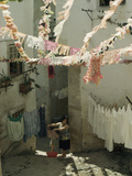 Woman Hangs Laundry in Alley Below Billowing St. Anthony Streamers Photographic Print by Volkmar K. Wentzel
