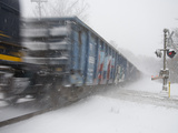 A Freight Train Rolls Through Heavy Snowfall of 'Blizzard of 2010' Photographic Print by Stephen St. John
