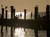 A Backlit View of People on a Pier Photographic Print by Karen Kasmauski