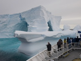 National Geographic Explorer Sails Past an Iceberg in the Weddell Sea Photographic Print by  Keenpress