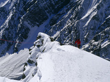 A Climber Ascends a Steep Section of Ice on Nanga Parbat's Slopes Photographic Print by Tommy Heinrich