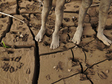 Kara Boys Stand on the Mud-Caked Shoreline of the Omo River Photographic Print by Randy Olson