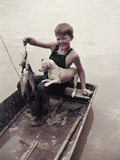 A Boy Proudly Displays His Catch of Spotted Channel Catfish Photographic Print by J. Baylor Roberts