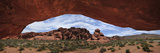 Rock Formations Through a Giant Arch in Valley of Fire State Park Photographic Print by Raul Touzon