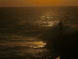 Silhouetted Recreational Fisherman at Twilight Photographic Print by Beverly Joubert