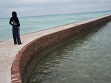 A Girl on a Walkway around Fort Jefferson Photographic Print by Karen Kasmauski
