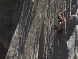 A Climber Clings with Fingertips to El Capitan Photographic Print by Mikey Schaefer
