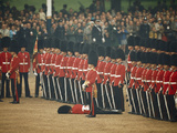 Irish Guards Remain at Attention after One Guardsman Faints Fotoprint van James P. Blair