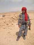 A Child Guard at a Site in Zhari Dasht, Near Kandahar, Afghanistan Photographic Print by Kris Leboutillier