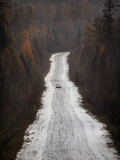 A Car on a Snow-Covered Road Through a Forest Near Ulaanbaatar Photographic Print by Aaron Huey