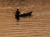 A Vietnamese Person in a Canoe on the Hoi an River at Daybreak Photographic Print by Karen Kasmauski