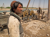 Two Workers Operate a Boring Machine in Arghandab, Afghanistan Photographic Print by Kris Leboutillier