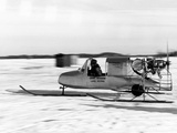 A Game Warden's Snowmobile Skims over Thin Ice on Lake Minnetonka Photographic Print by Thomas J. Abercrombie