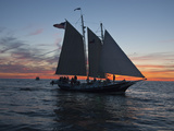 A Sailboat Off Grand Haven Pier on Lake Michigan at Twilight Photographic Print by Karen Kasmauski