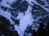 An Avalanche Rumbles Down the Steep Slopes of Nanga Parbat Photographic Print by Tommy Heinrich