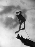 An Ice Fisherman Drags a Carp Upward Toward a Hole in the Lake's Ice Photographic Print by Thomas J. Abercrombie