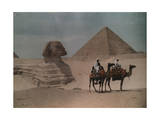 Two Men on Camelback Ride Past the Sphinx and Great Pyramid Photographic Print by Hans Hildenbrand